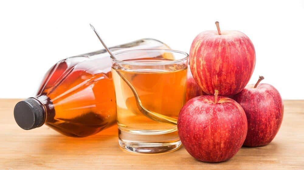 Apple cider vinegar in jar, glass and fresh apple, healthy drink