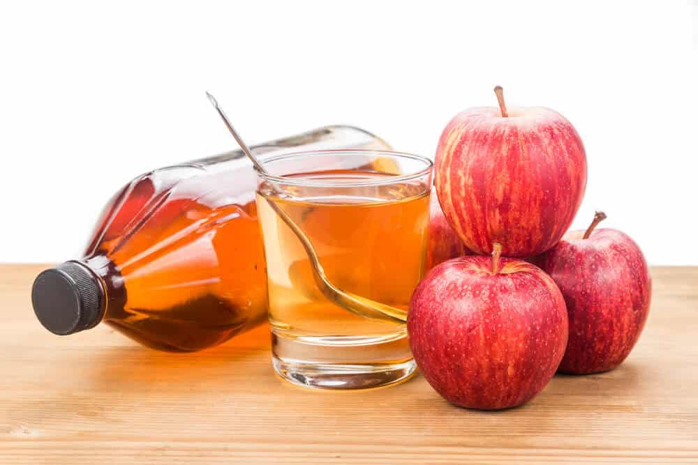 Apple cider vinegar in jar, glass and fresh apple, healthy drink