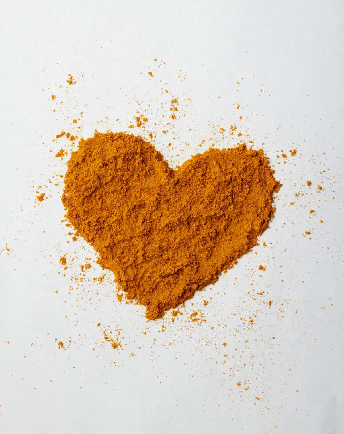 Turmeric powder in a heart shape