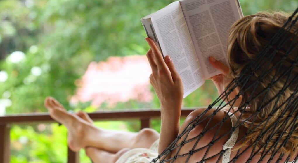 Reading a book by the garden