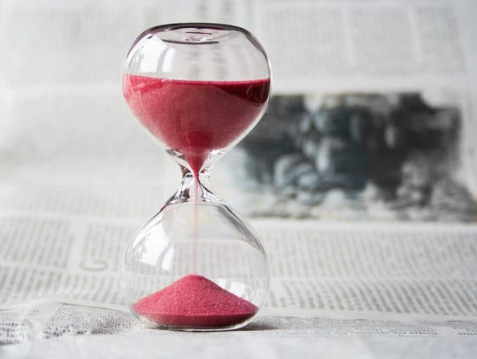 Red sand in hourglass
